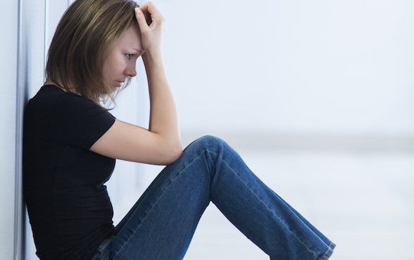 sad young woman sitting  in crisis moment