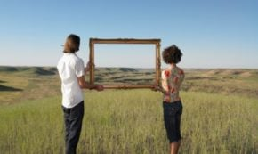 http://www.gettyimages.com.au/detail/photo/man-and-woman-holding-frame-in-open-land-royalty-free-image/82404235
