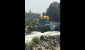 Man Somehow Navigates Down Rapids Sitting A Top Six Stacked Rafts