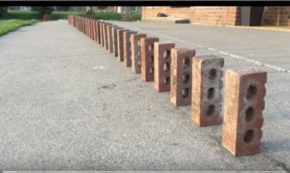 Watching A Double Domino Effect With Bricks Is Just Incredibly Satisfying