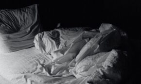 rumpled bed black and white